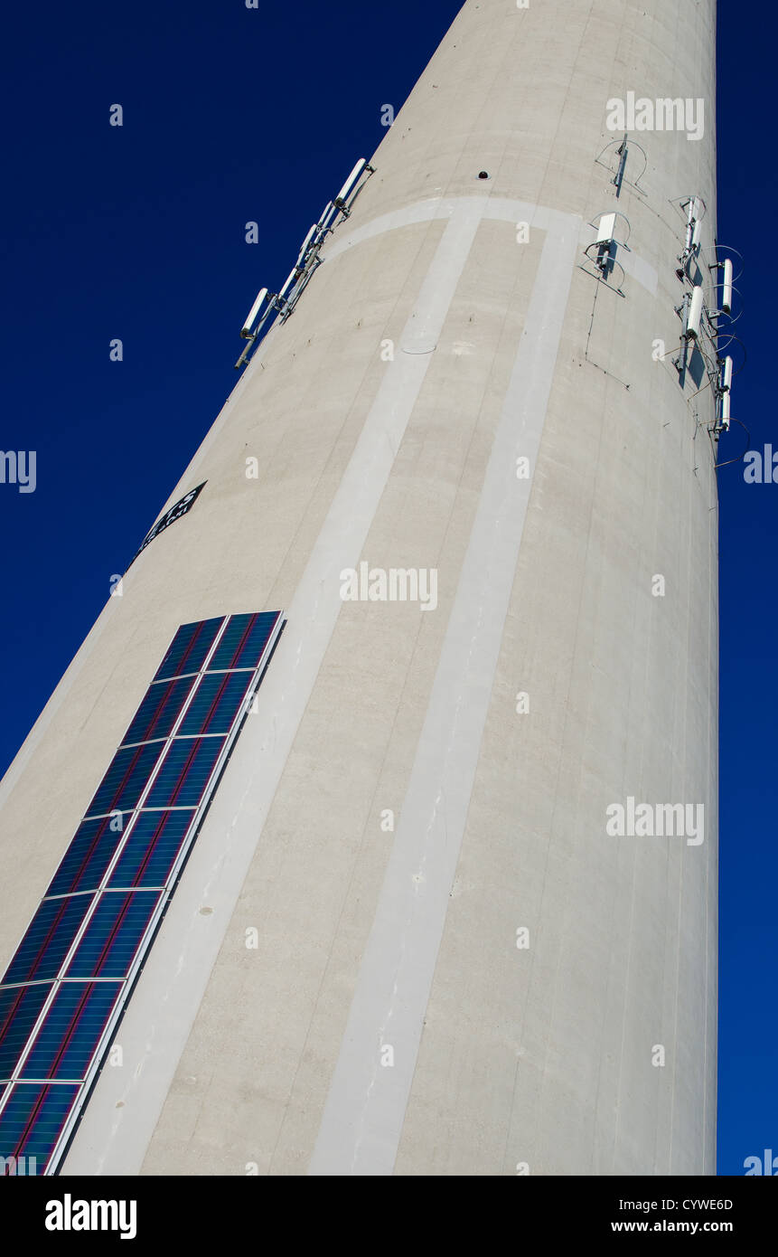Tower with solar panels and antennas - Stock Image