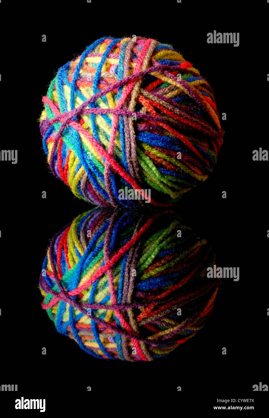 ball of colorful wool yarn on black Stock Photo