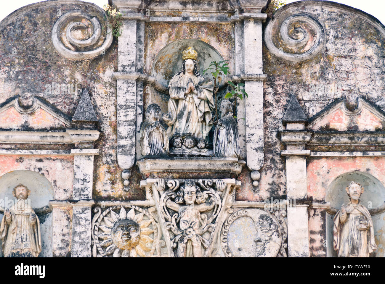 Intricate carvings on the exterior of a partially ruined church in Antigua, Guatemala. - Stock Image
