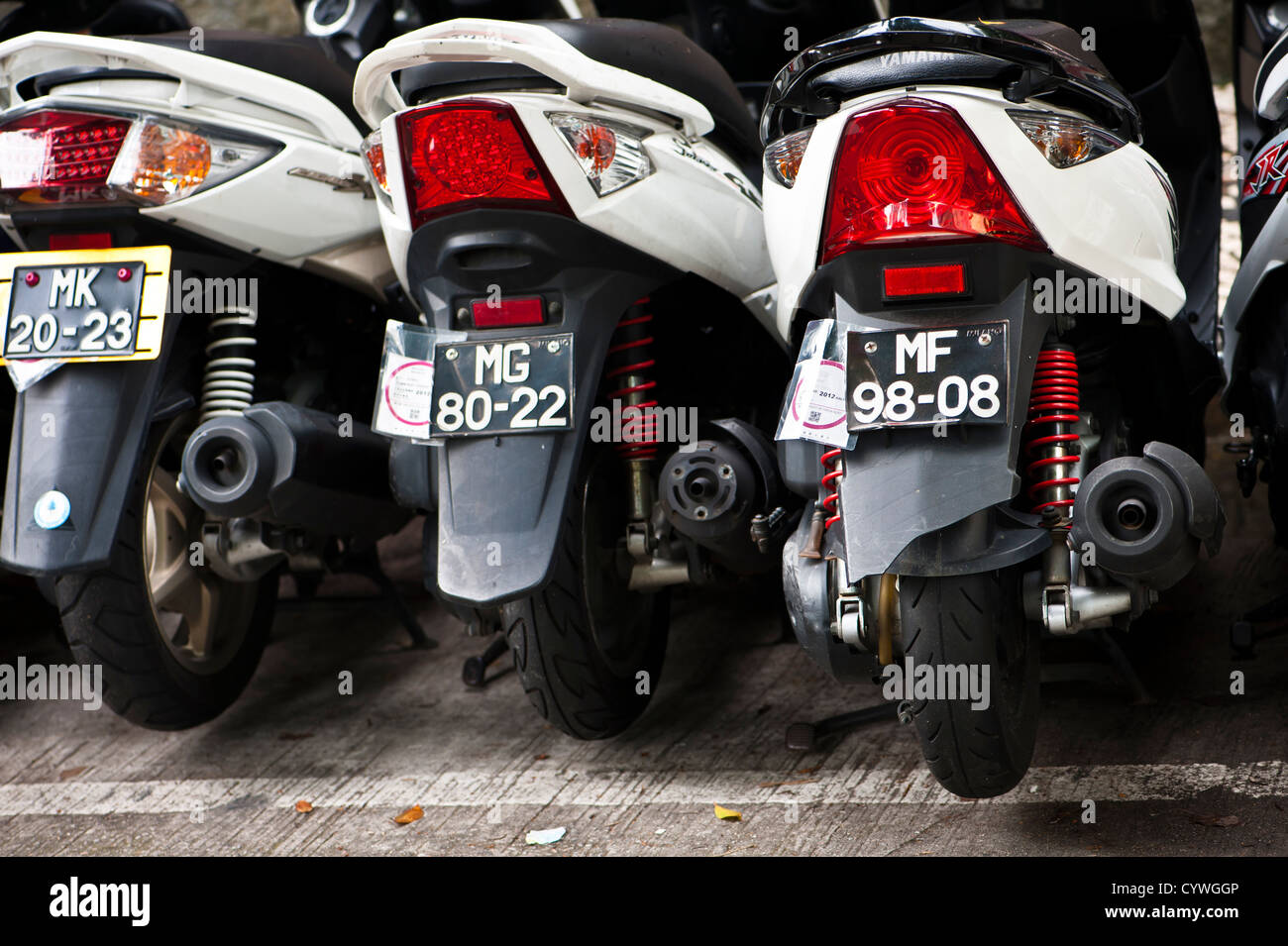 Scooters parked together in Macau - Stock Image