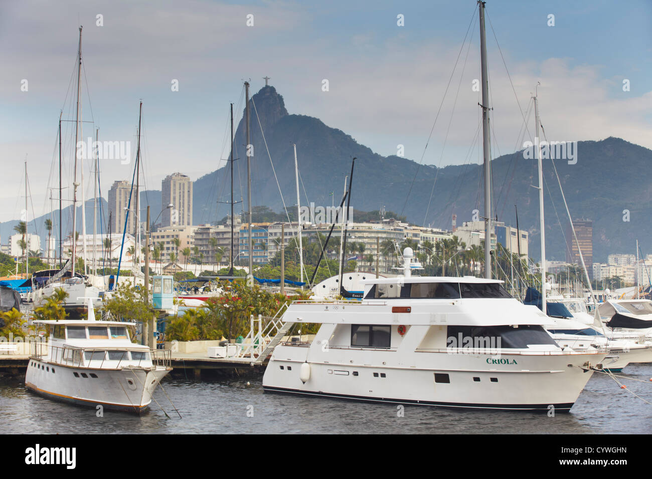 Boats in Guanabara Bay with Christ the Redeemer statue in background, Urca, Rio de Janeiro, Brazil Stock Photo