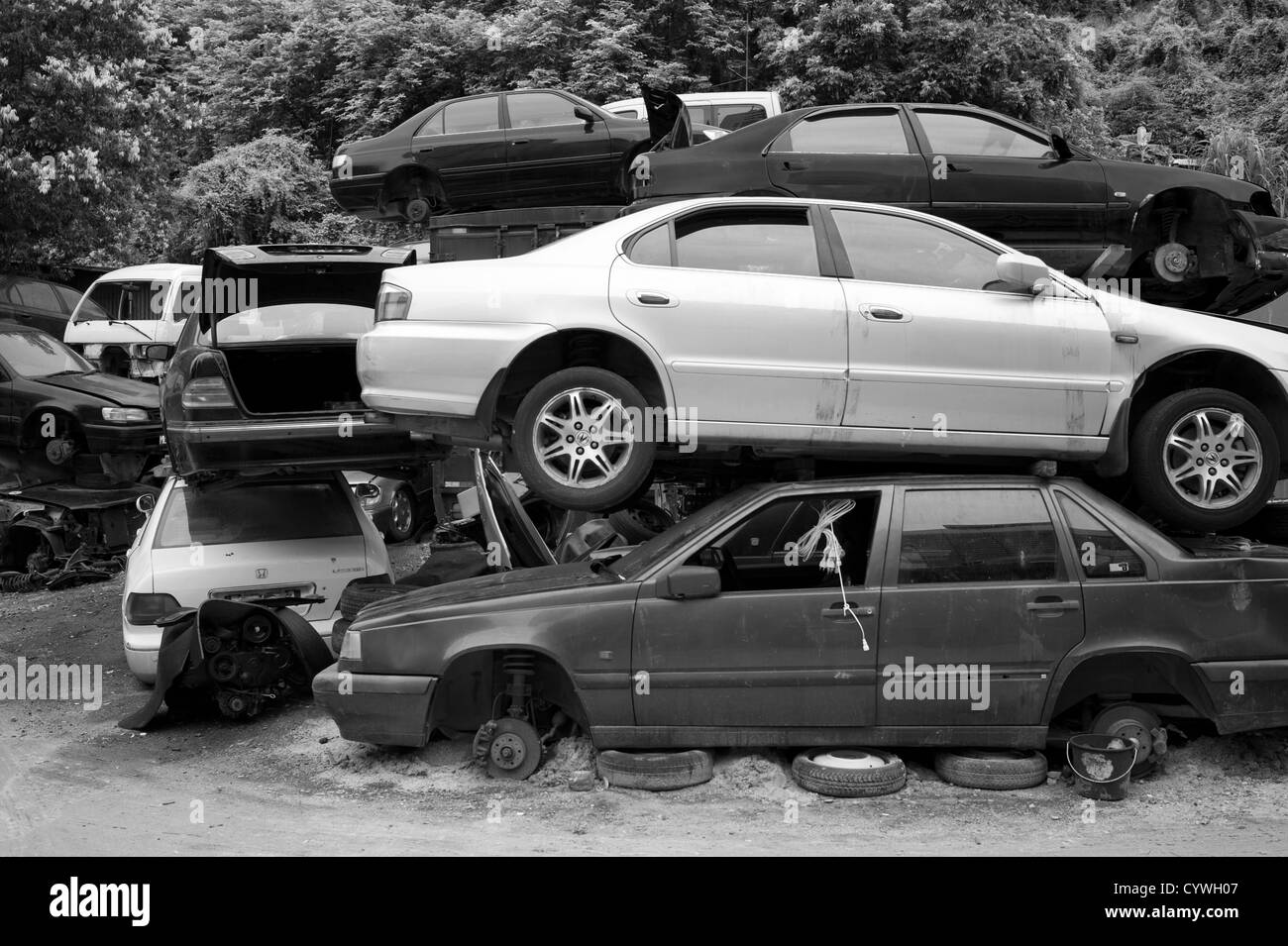 Cars piled up in a wreckers yard,macau Stock Photo: 51578583 - Alamy