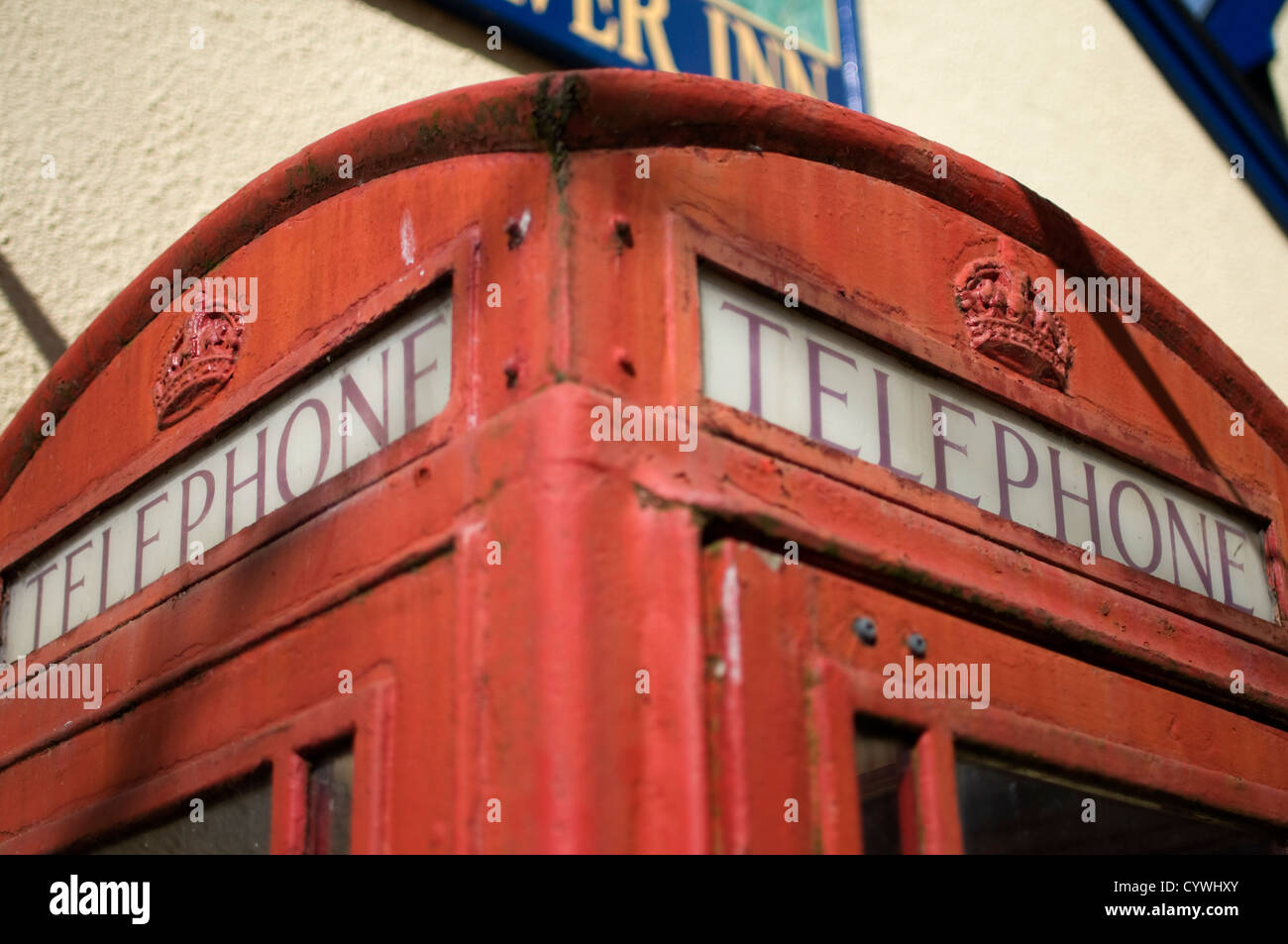 Traditional London red telephone box with signs of wear Stock Photo