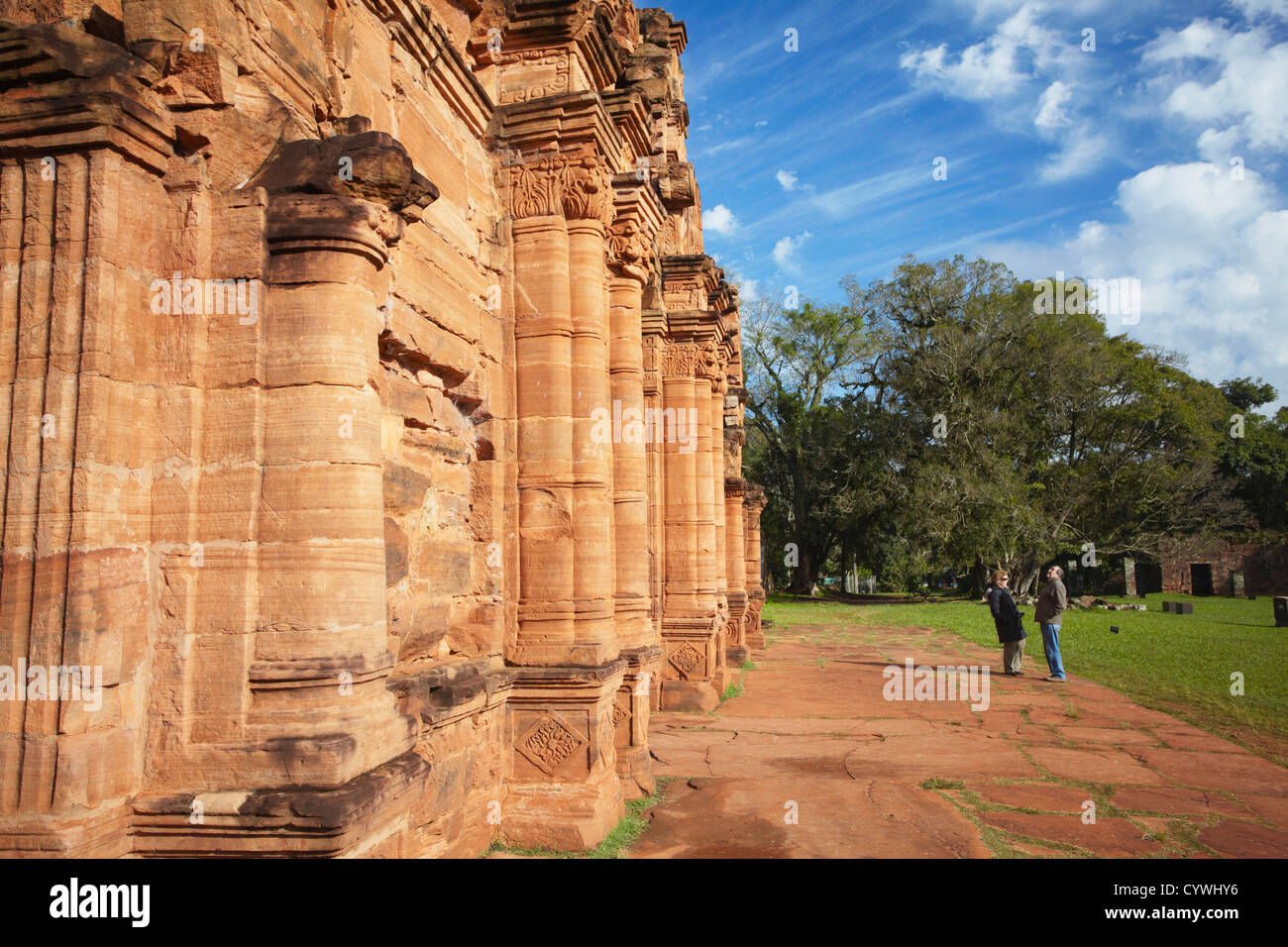 Tourists at ruins of mission at San Ignacio Mini (UNESCO World Heritage Site), Misiones, Argentina - Stock Image