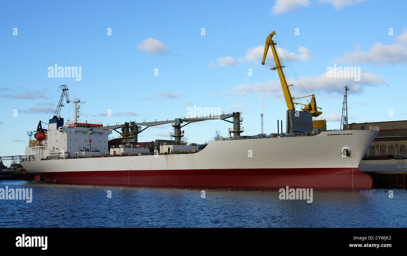 The cargo ship costs at a mooring - Stock Image