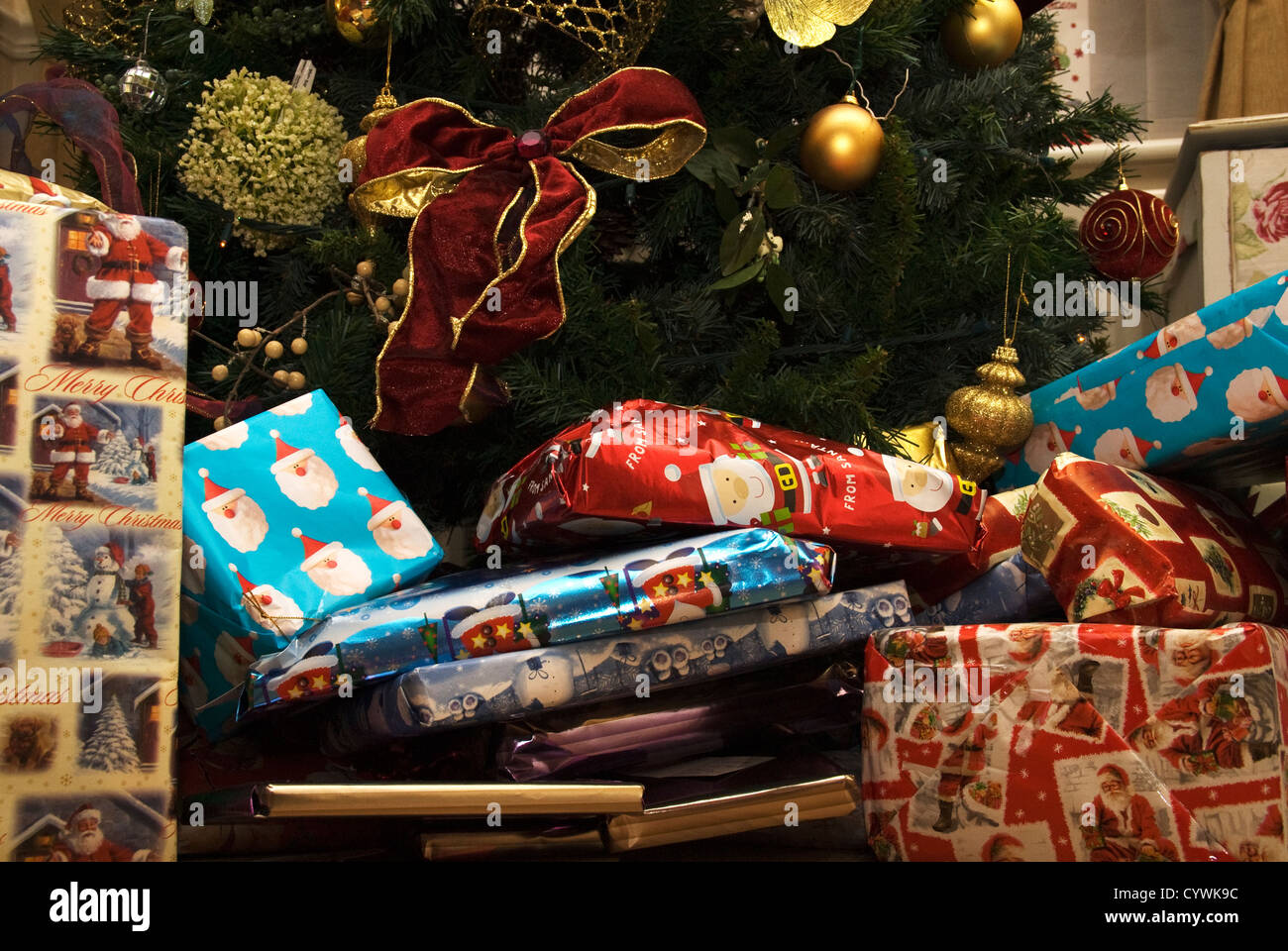 Christmas presents underneath a Christmas tree - Stock Image