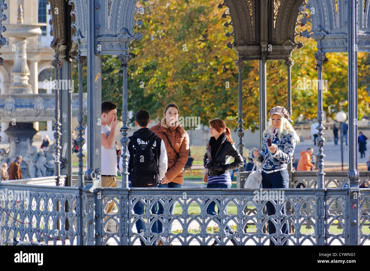 Stuttgart Baden-Württemberg South Germany: Schlossplatz Pavillion, young people and blond woman with cap and - Stock Image