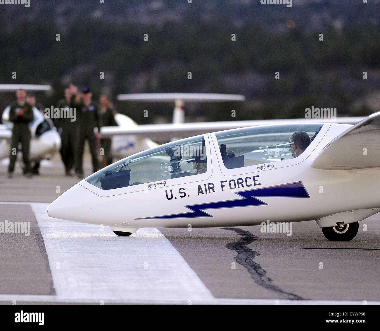 EPSN's Charissa Thompson gestures after receiving a glider orientation flight by Cadet 1st Class James Bloch - Stock Image
