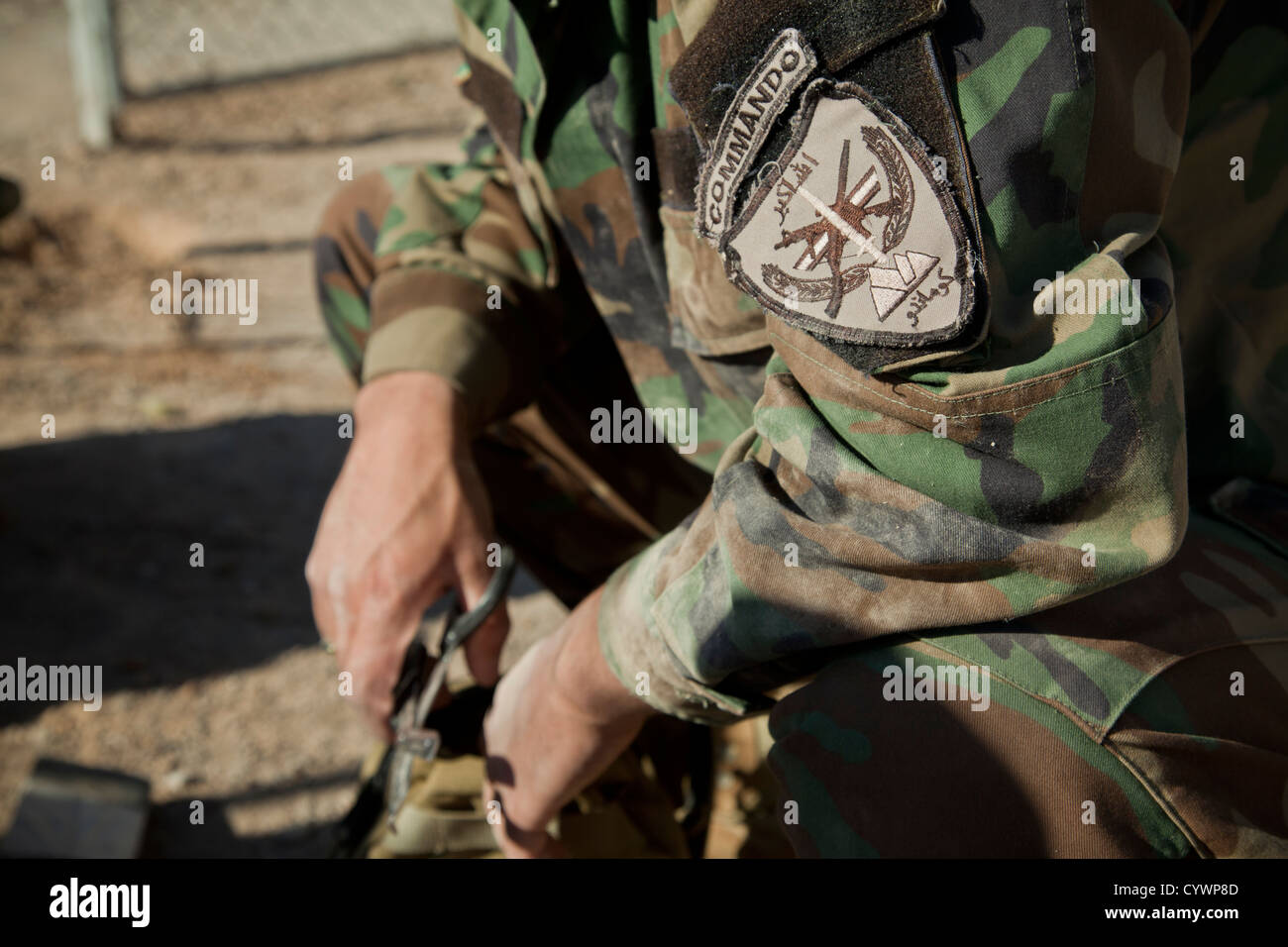 A commando with 9th Special Operations Kandak, Afghan National Army, listens to instruction during counter improvised - Stock Image