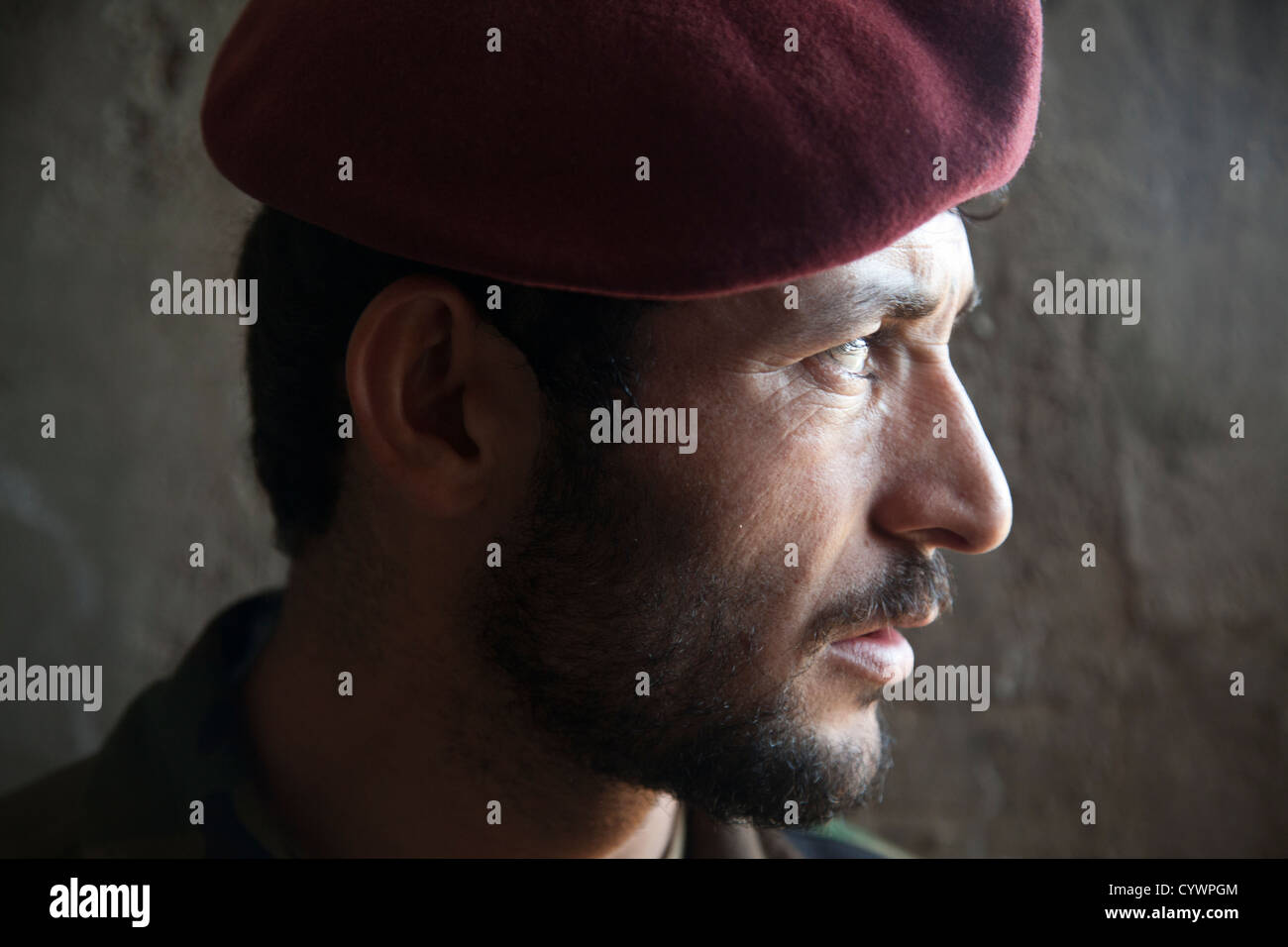 A commando with 9th Special Operations Kandak, Afghan National Army, looks out from a notional cache site during - Stock Image