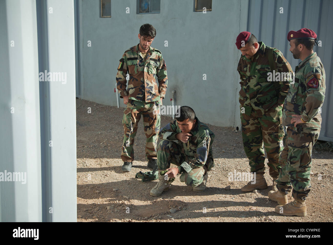 Commandos with 9th Special Operations Kandak, Afghan National Army, discuss their next step during counter improvised - Stock Image