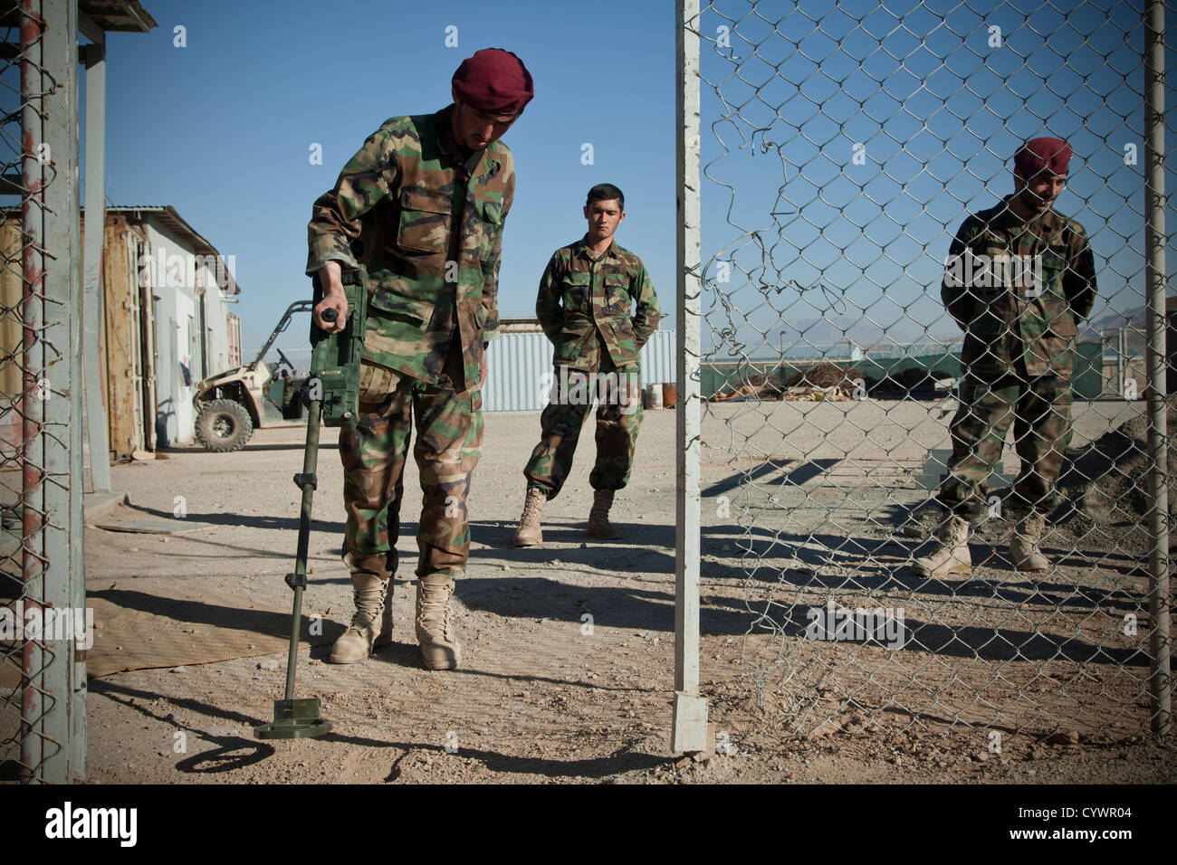 A commando with 9th Special Operations Kandak, Afghan National Army, sweeps for notional improvised explosive devices - Stock Image