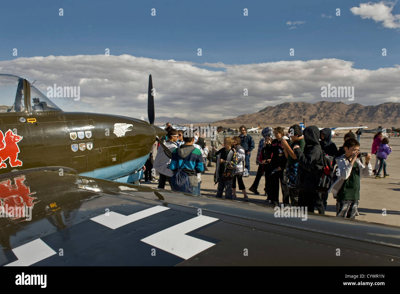 Students from the Innovations International Charter School of Nevada look at vintage aircraft on display at Aviation - Stock Image