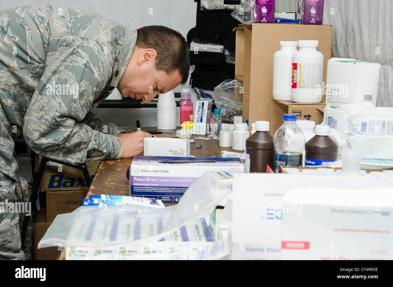 An Air National Guardsman of the Medical Group, Air National Guard Base, Scotia, N.Y., assists service members at Stock Photo