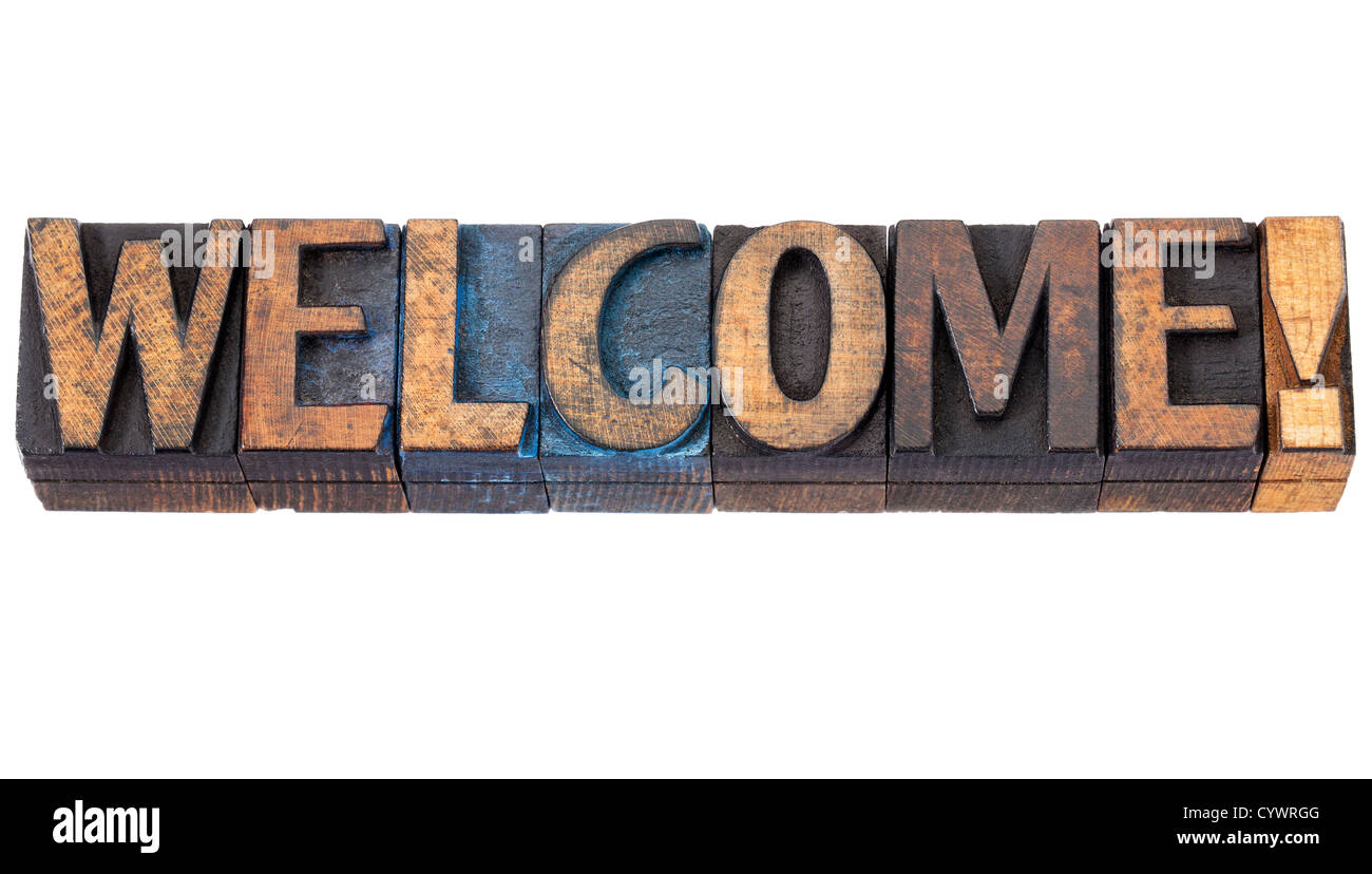 welcome word - isolated text in vintage letterpress wood type blocks stained by red, blue and black ink - Stock Image