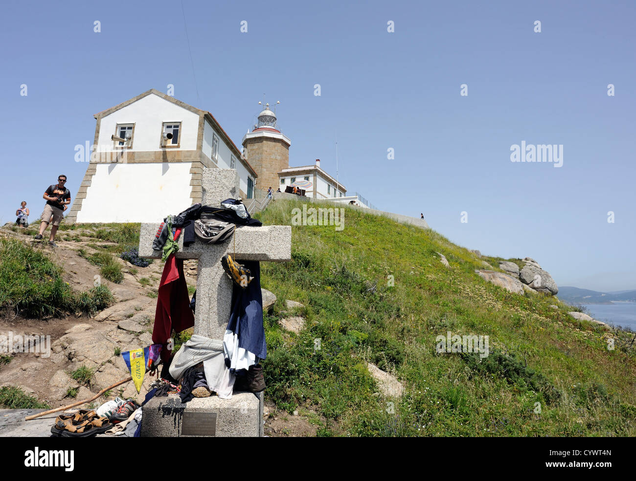 A stone cross on Cape Finisterre, Cabo Fisterra, where pilgrims on the Way of St James have burned or left  their - Stock Image