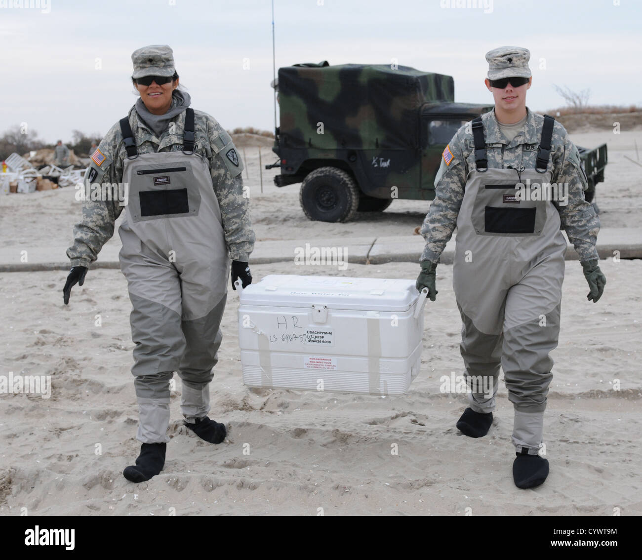 Specialists Maria R. Gutierrez and Stacie L. Solis from the 227th Preventive Medicine Detachment, 56th Multifunctional - Stock Image