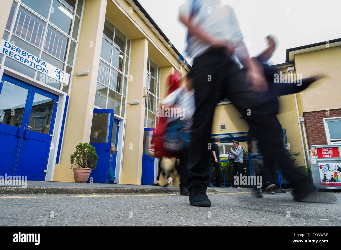 At the end of the day pupils leaving a secondary school, Wales UK - Stock Image