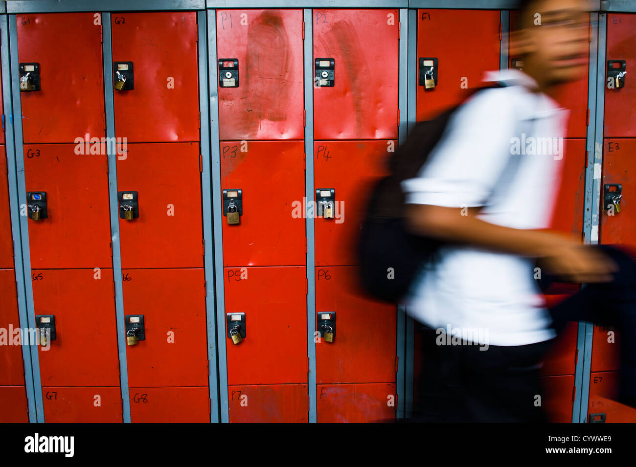 Blurred pupils in the corridor of a secondary school, Wales UK - Stock Image