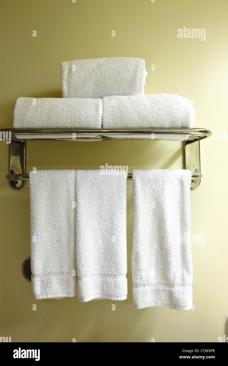 White towels on a towel rack - Stock Image