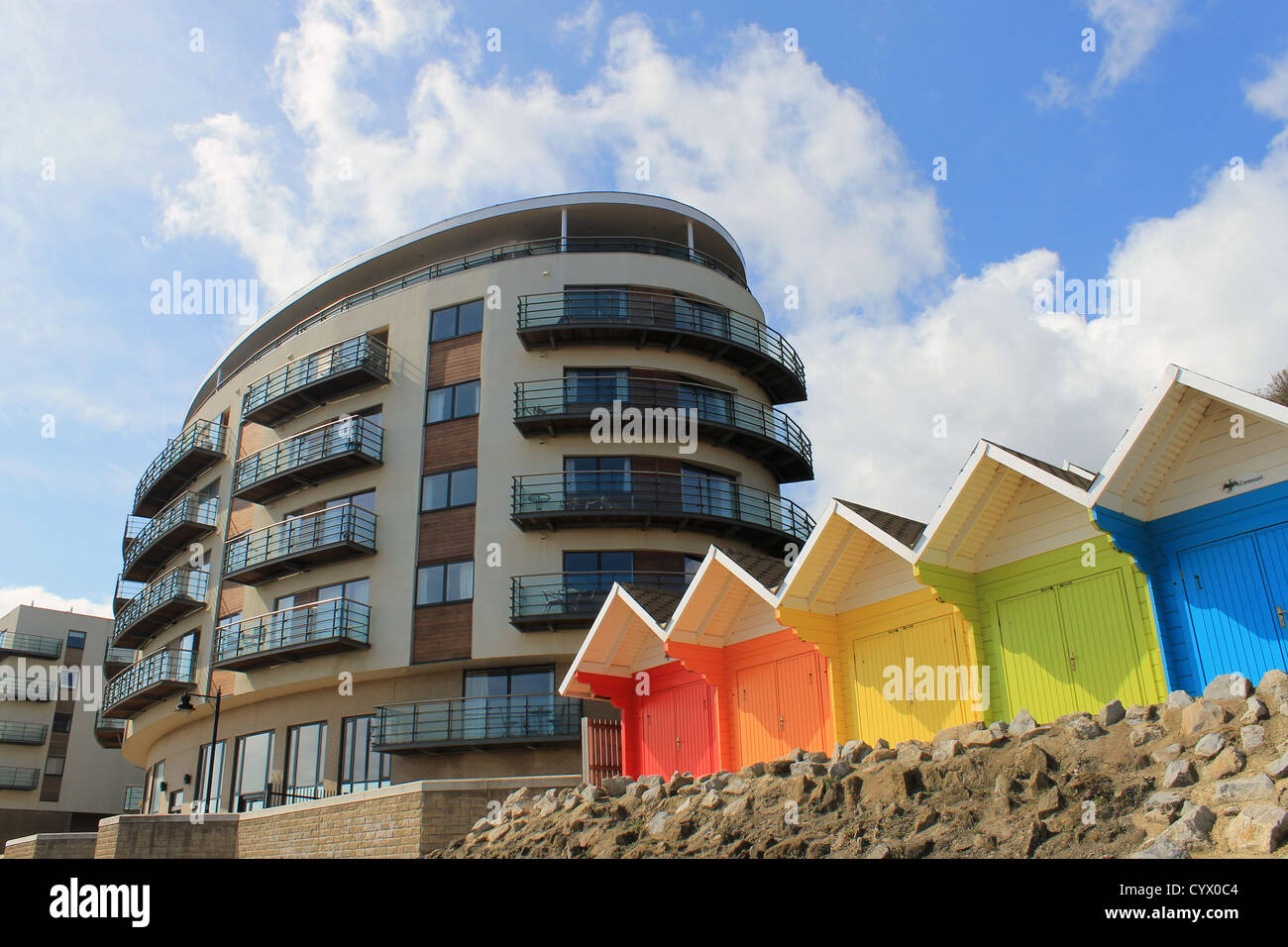 Scenic view of colorful chalet buildings with modern hotel in background, Scarborough, England. - Stock Image
