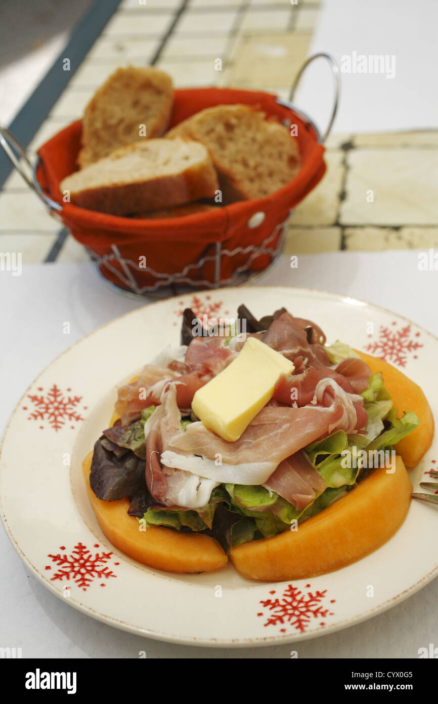 Prosciutto and Melon served in French restaurant in Périgueux, France - Stock Image