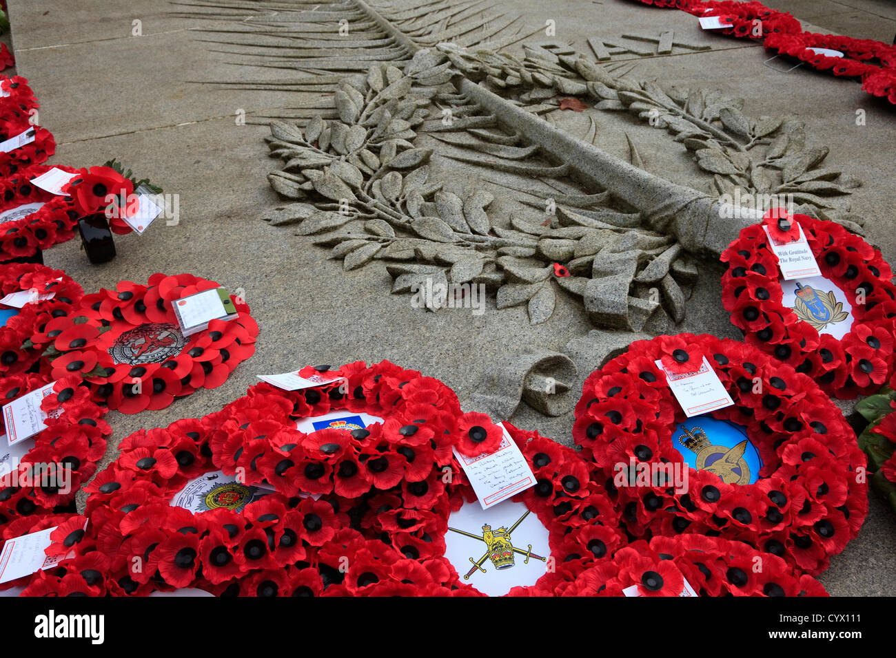 11 November 2012, Remembrance Day Parade, George Square, Glasgow, Scotland. Poppy wreathes placed on the granite - Stock Image