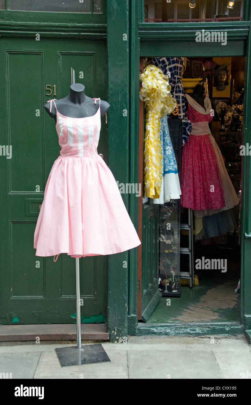 1bfc393bc88 Vintage 1950 s pink and white gingham summer dress on stand outside clothes  shop with more dresses showing within Covent Garden