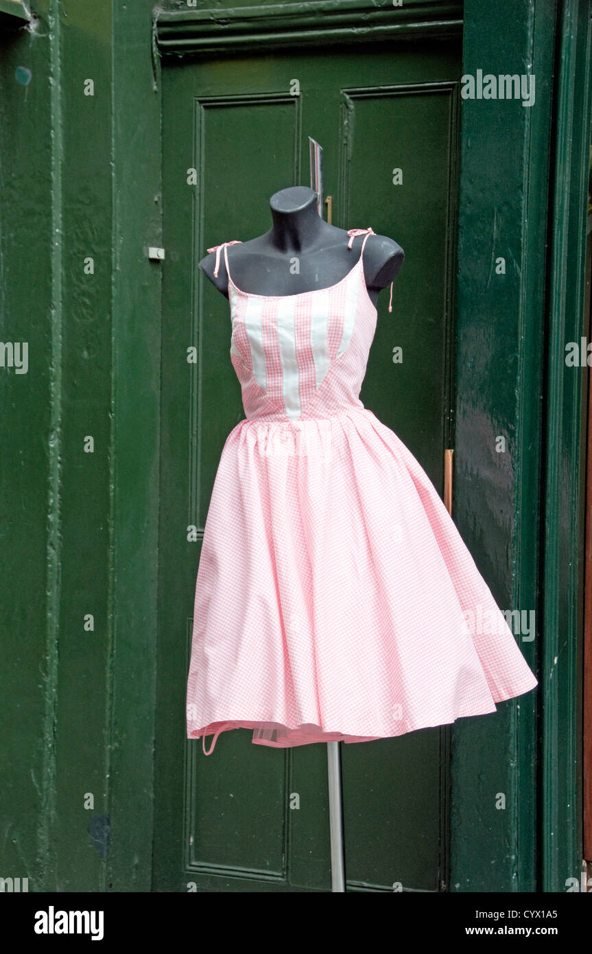 a0b678c970d Vintage 1950 s pink and white gingham summer dress blowing in the wind on  stand outside clothes shop in Covent Garden