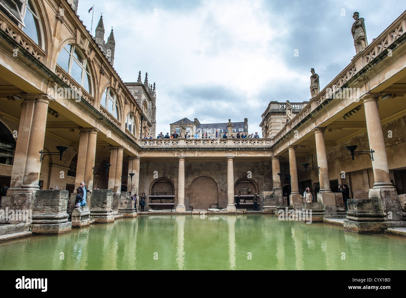 BATH, UK - A water-level view of the Roman baths in Bath, Somerset. The original location was used during the Roman - Stock Image