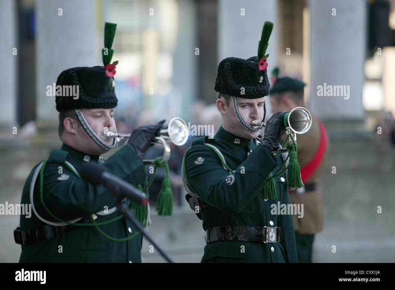 Two Buglers sound the last post at the Cenotaph in Belfast on the national day of remembrance. - Stock Image
