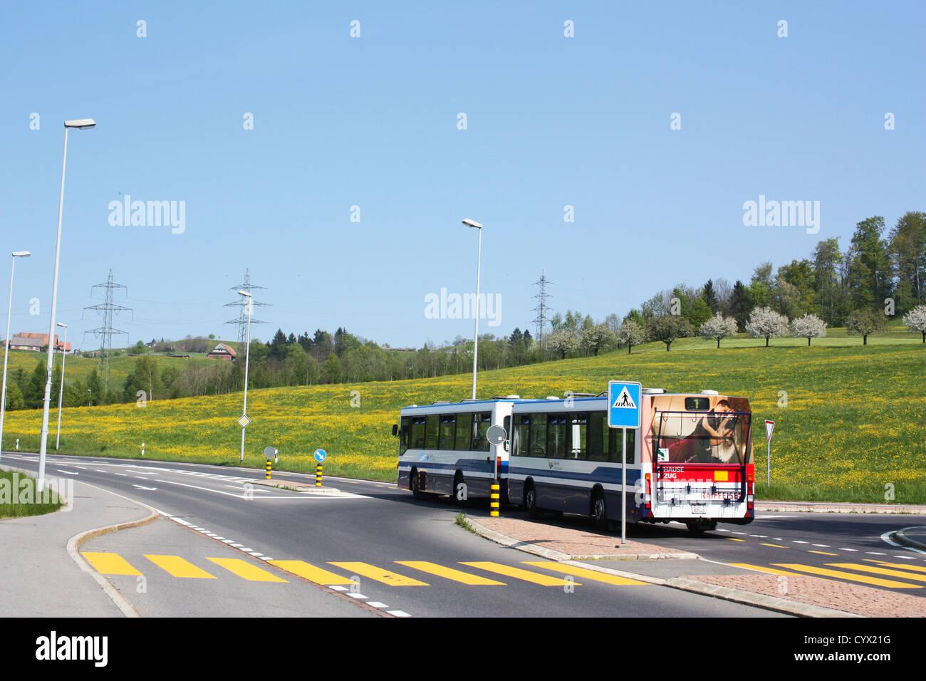 Bus on road in Switzerland Stock Photo