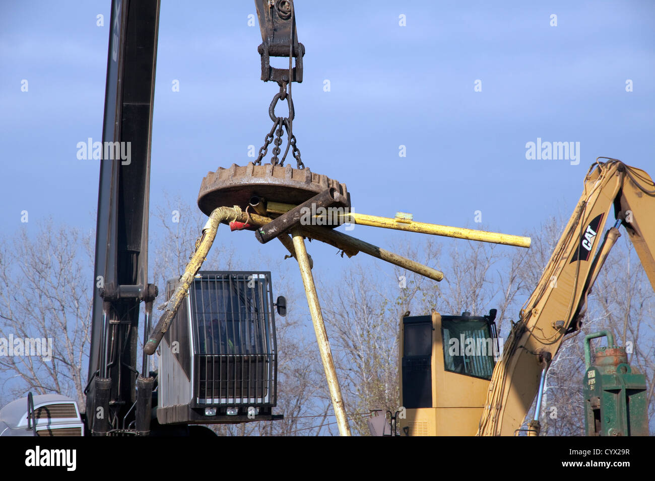 Electromagnetic Crane lifting steel and metal scrap for shredder at Recycling Plant E USA - Stock Image