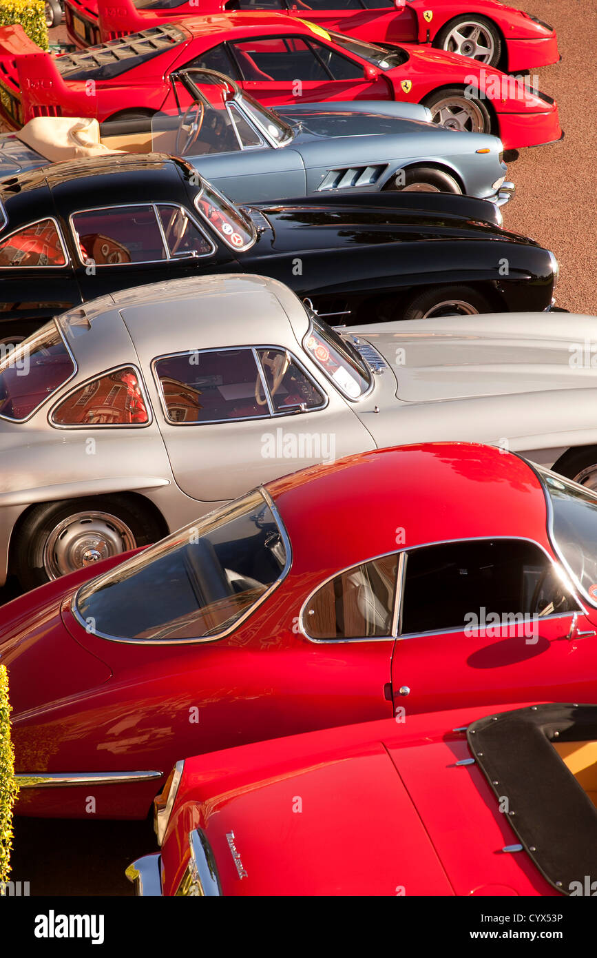Royal Automobile Club Woodcote Park Salon Prive tour. A group of classic cars parked at tour start. - Stock Image