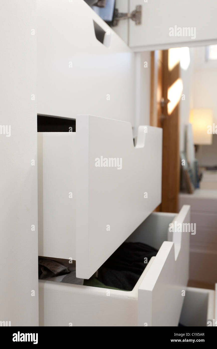 Open bedroom drawers in close up - Stock Image