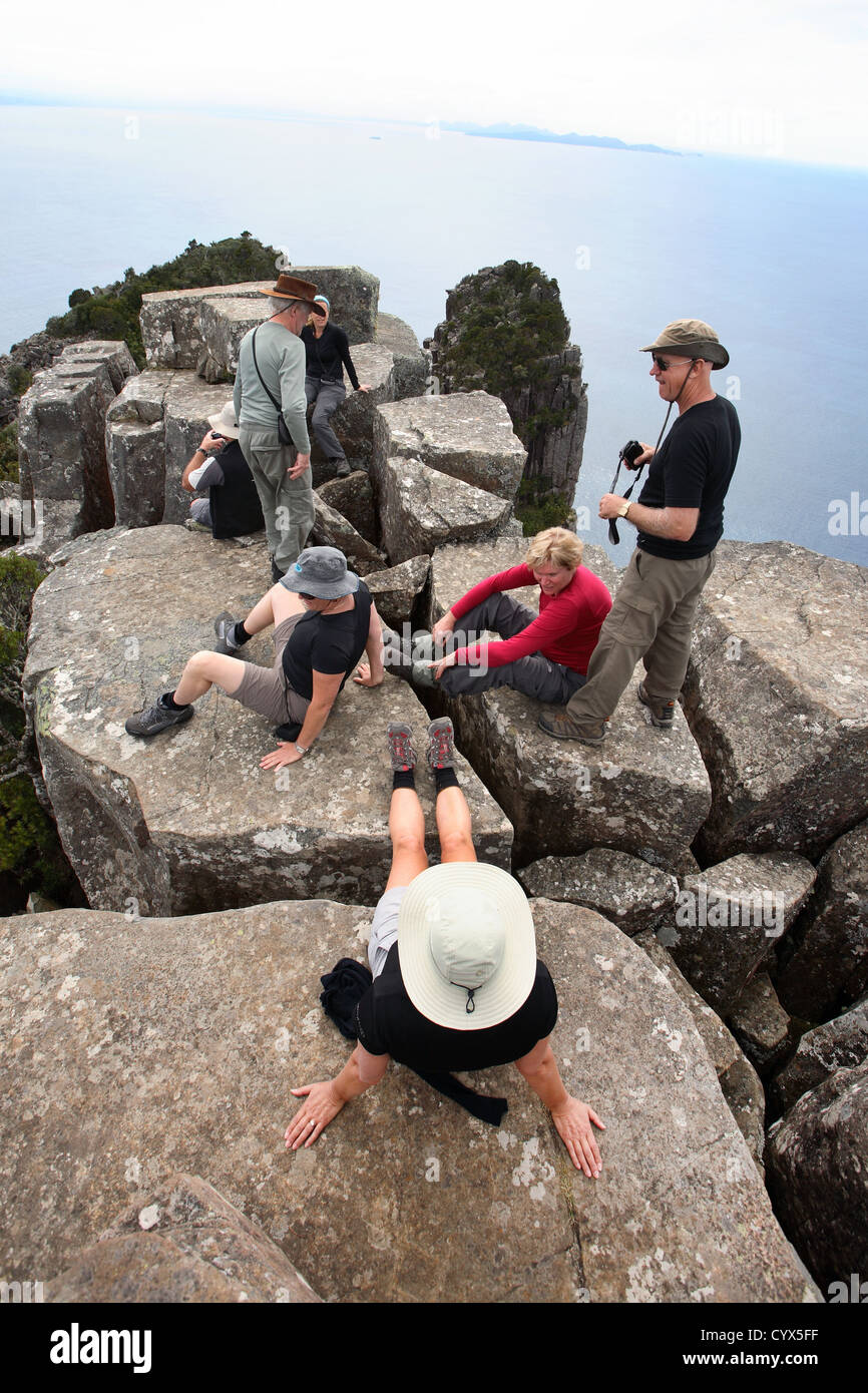 Walkers on top of Bishop and Clerk (620 m). Maria Island, Tasmania, Australia. - Stock Image