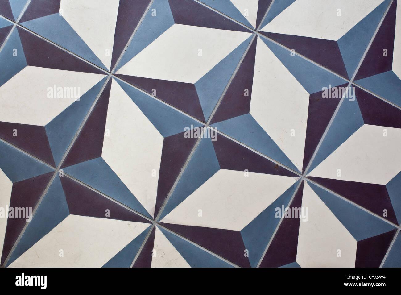 Kitchen floor with handpainted floor tiles. - Stock Image