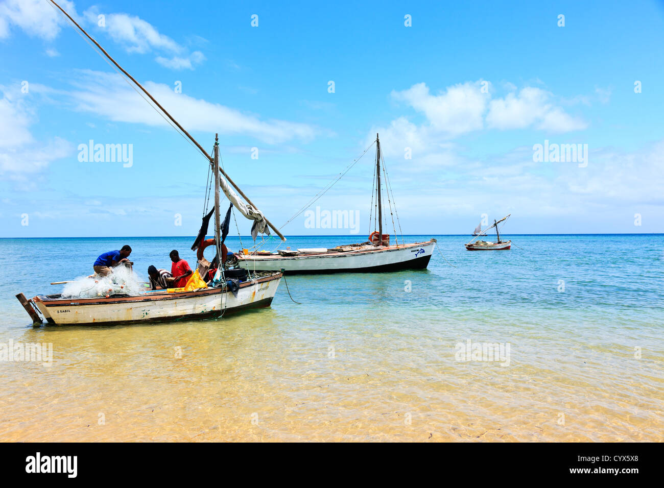 Fishermen ready their nets for a days fishing on Inhaca Island Mozambique Stock Photo