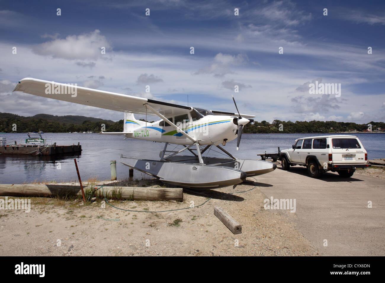 Seaplane taking tourists on scenic flight along the Gordon River. Strahan, West Tasmania, Australia. - Stock Image