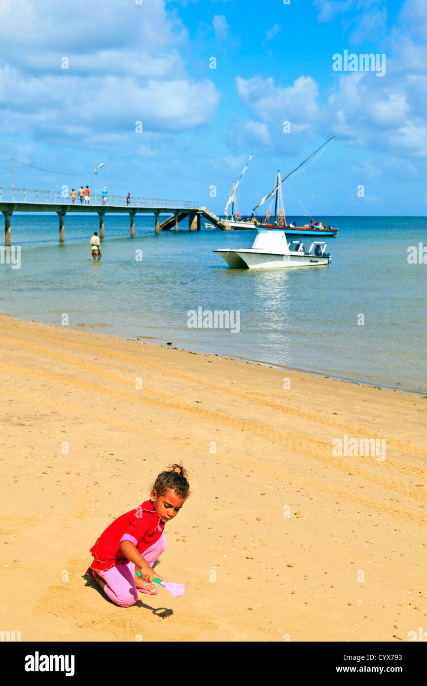 A young mixed race child plays on the sand. Inhaca Island Mozambique Stock Photo
