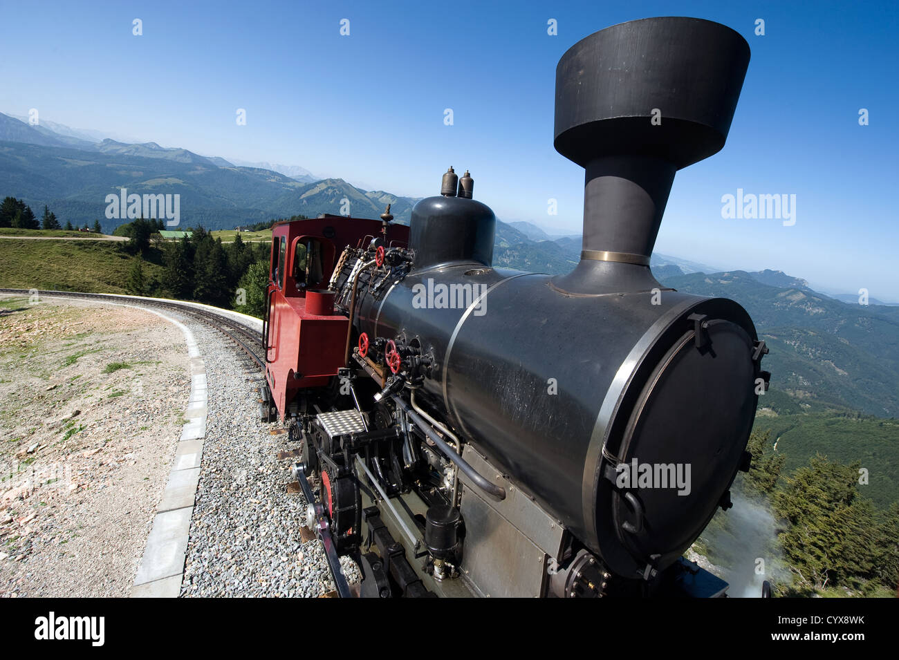 An old steam locomotive is climbing up the 'schafbergbahn' on to the top of the Schafberg (1783 meters) - Stock Image