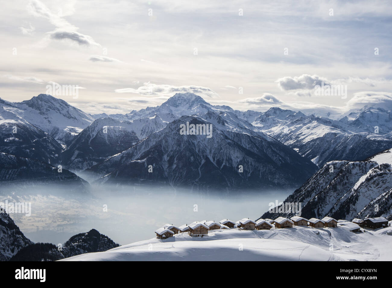 a view over the Swiss village of Bel Alp from the air with the Valais mountains in the background - Stock Image