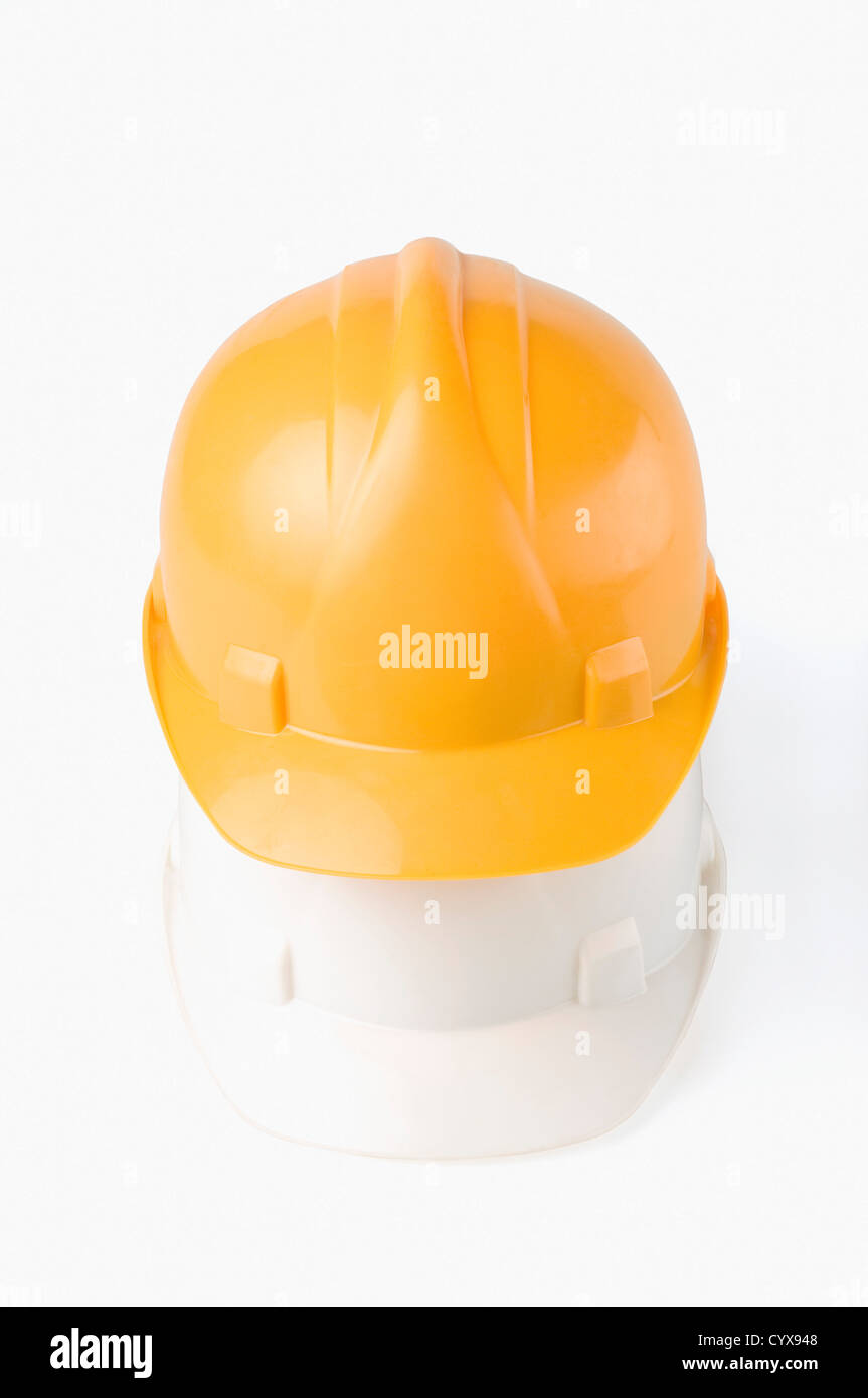 Close-up of two hardhats - Stock Image