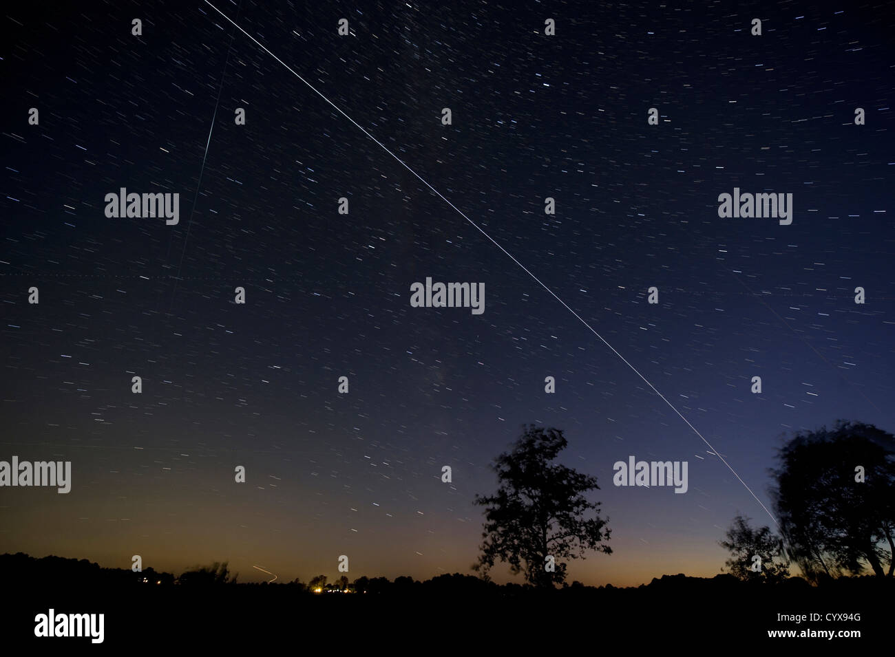 The ISS passing by over the evening sky in The Netherlands - Stock Image