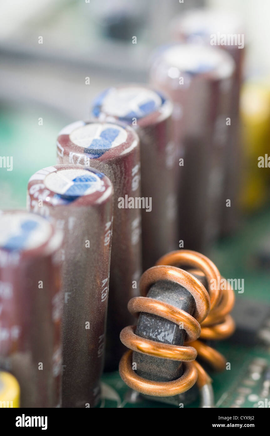 Close-up of capacitors in a circuit board - Stock Image