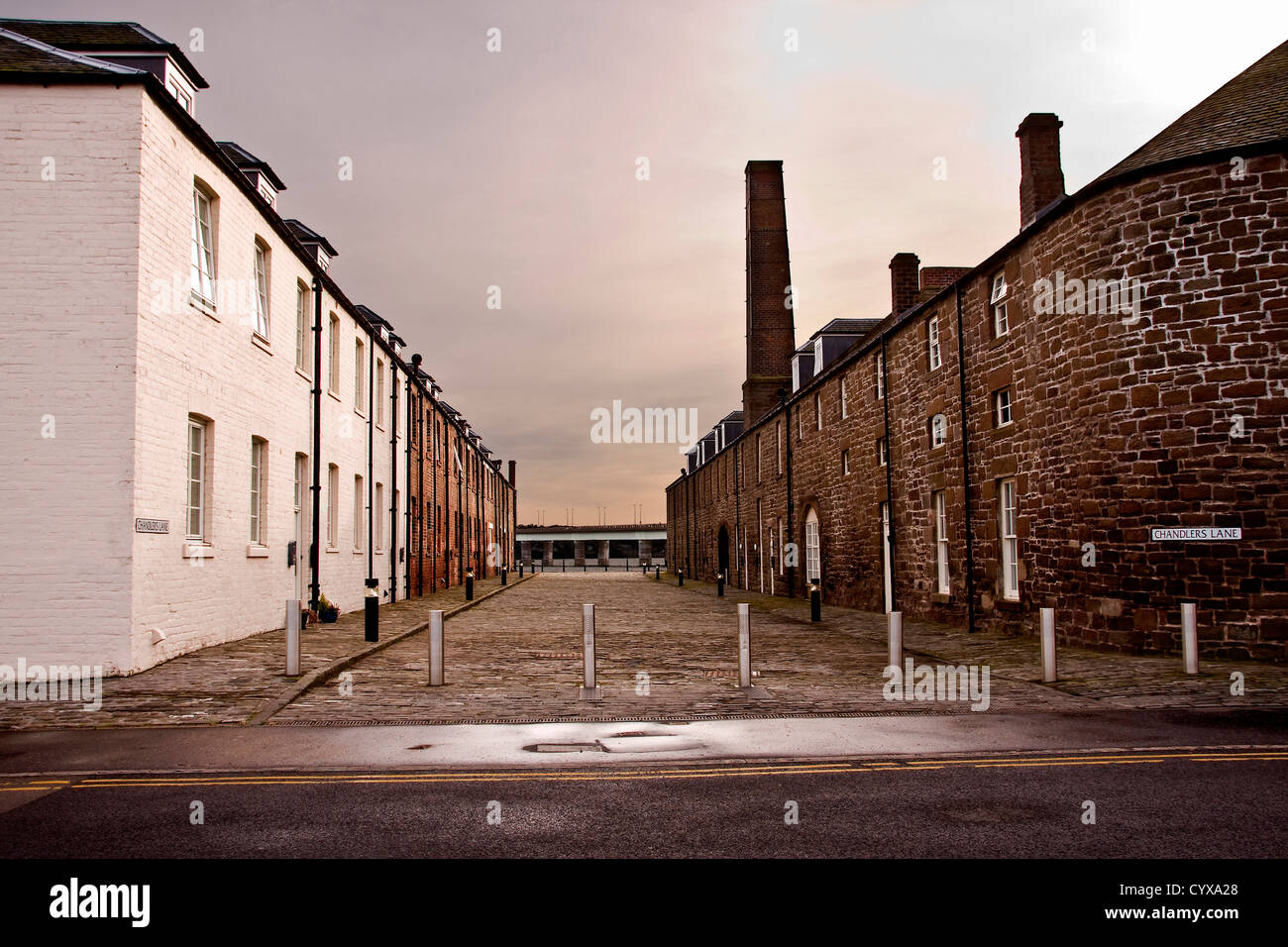 Cobbled street with modern housing which once was the Ferryman`s Quarters at the Victoria Docks,City Quay in Dundee,UK Stock Photo