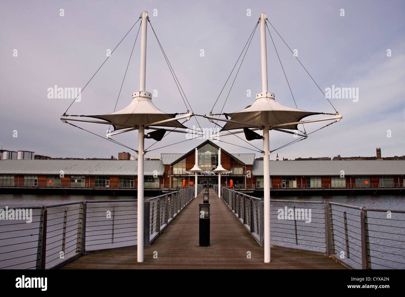 Narrow foot bridge crossing the Victoria Dock to the City Quay retail buildings in Dundee,UK Stock Photo