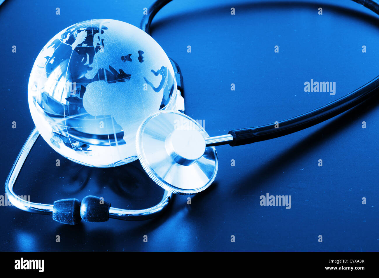 ecology eco environment or global warming concept with glass globe and stethoscope - Stock Image