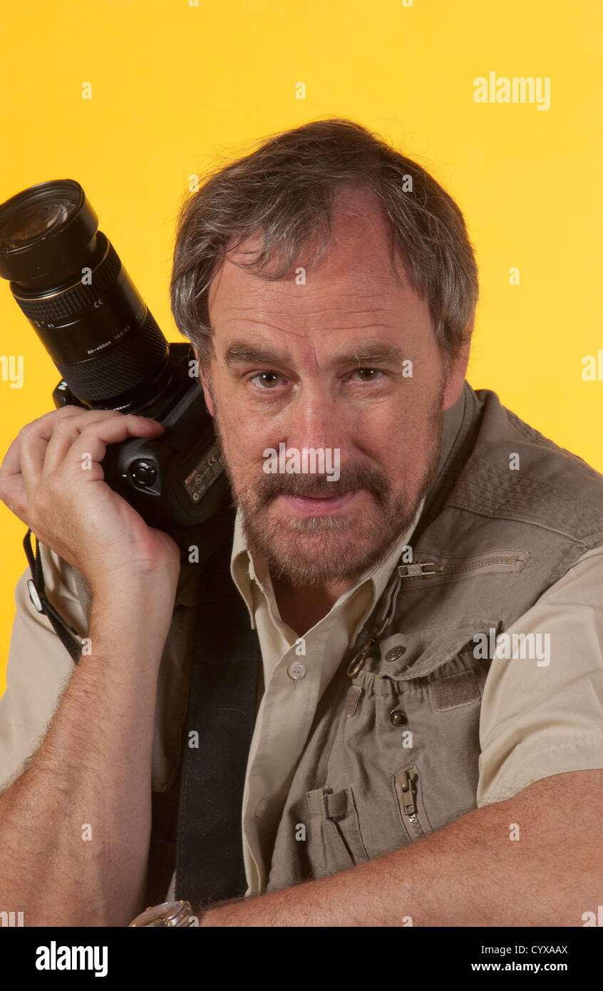 Photographer preparing to capture action. - Stock Image