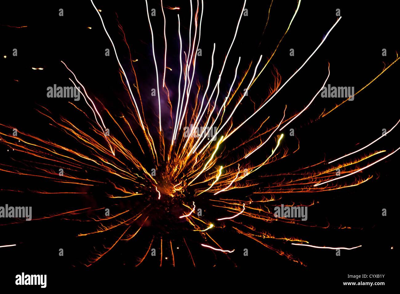 firework exploding  fills frame in black sky - Stock Image